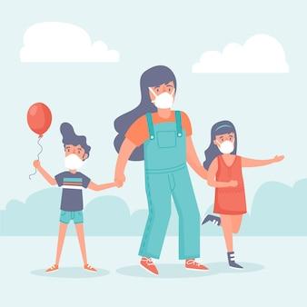 Madre che cammina con i bambini mentre indossa maschere mediche