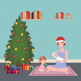 Madre e bambini con albero di natale