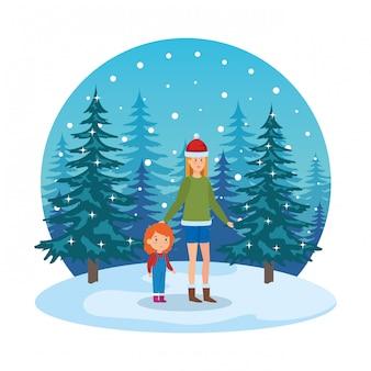 Madre e figlia con abiti invernali in snowscape