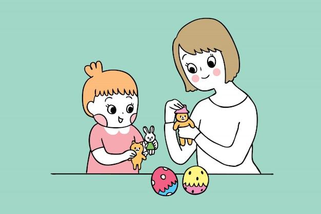 Madre sveglia e figlia del fumetto che giocano giocattolo