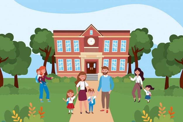 Madri e papà con i loro figli e ragazzi studenti nella scuola