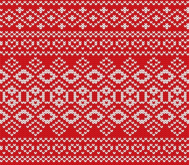 Maglione lavorato a maglia con ornamenti invernali. trama di maglia maglione di colore rosso.