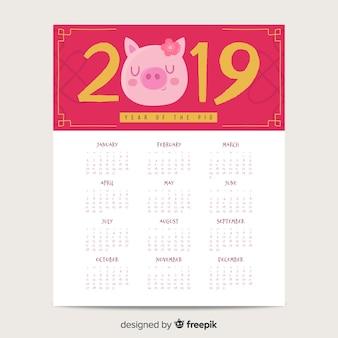 Maiale con il calendario cinese del nuovo anno del fiore