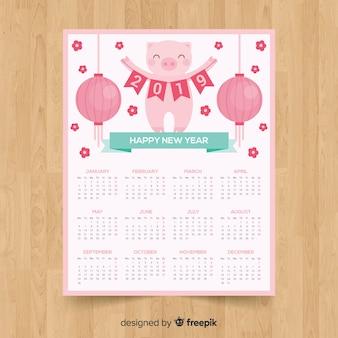 Maiale con il calendario cinese del nuovo anno della ghirlanda