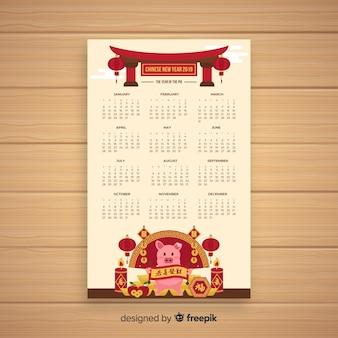 Maiale con il calendario cinese del nuovo anno delle candele