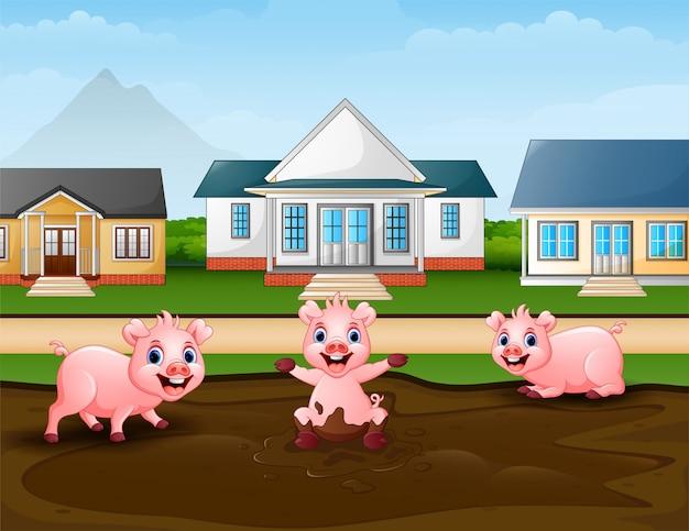 Maiali del fumetto che giocano una pozza di fango nel rurale