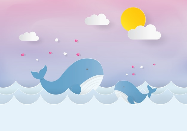 Mamma e bambino balena in mare, taglio carta