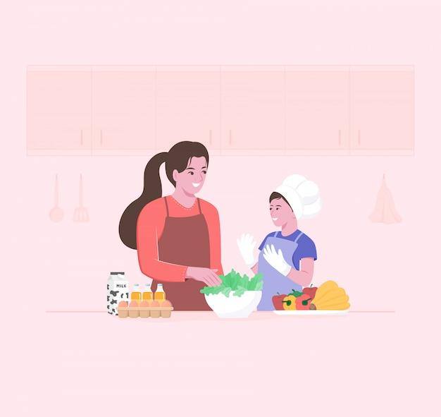 Mamma e bambino felici che preparano le insalate della verdura fresca nella cucina. kid partecipando alla cucina.