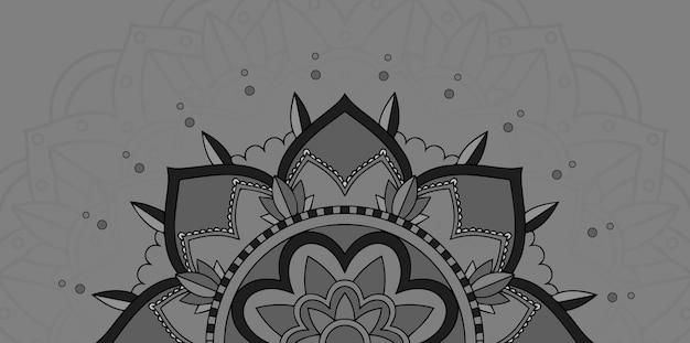 Mandala design su sfondo grigio