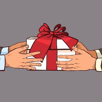 Mani che danno regalo ad un altro saluto con le feste, scatola del presente schizzo con fiocco rosso