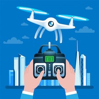 Mani che guidano drone tramite telecomando