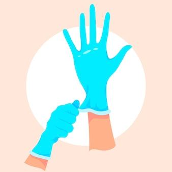 Mani che indossano guanti chirurgici protettivi