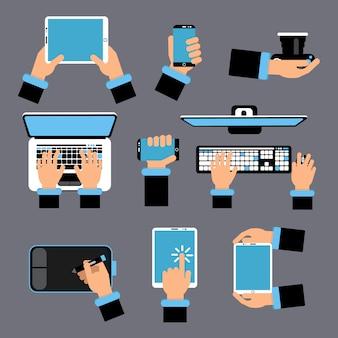 Mani che tengono diversi dispositivi del computer. laptop, smartphone, tablet e altri gadget.
