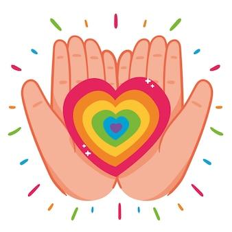 Mani che tengono il cuore arcobaleno