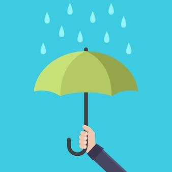 Mani che tengono l'illustrazione piana di vettore di progettazione dell'ombrello della pioggia