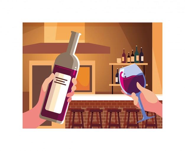 Mani che tengono una bottiglia e un bicchiere di vino