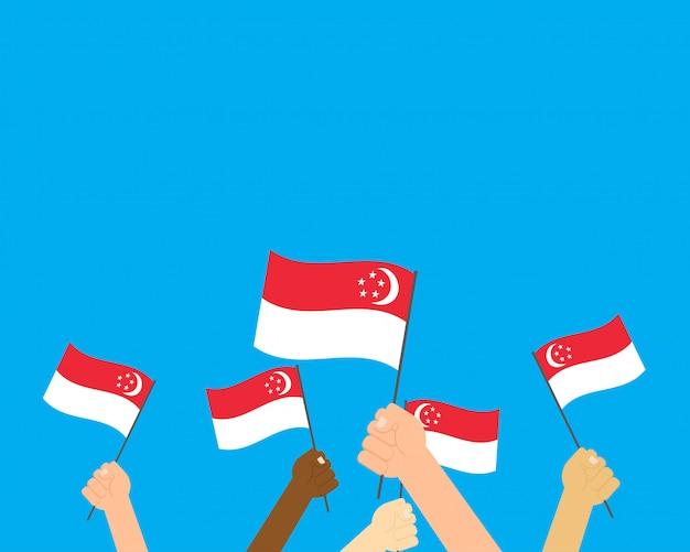Mani dell'illustrazione di vettore che tengono le bandiere di singapore