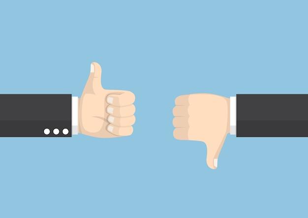 Mani dell'uomo d'affari che mostrano il pollice su e il pollice giù di gesto differente, voto e concetto di feedback