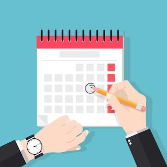 Mani dell'uomo d'affari con la penna segna la data nel calendario. termine e concetto di promemoria di eventi importanti.