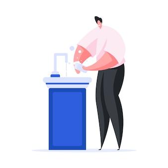 Mani felici di lavaggio dell'uomo con sapone sopra il lavandino