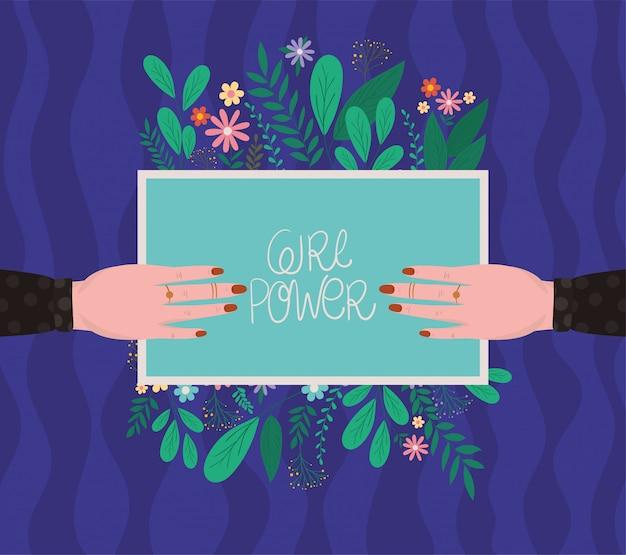 Mani femminili che tengono il cartello di potere della ragazza con progettazione di vettore dei fiori e delle foglie