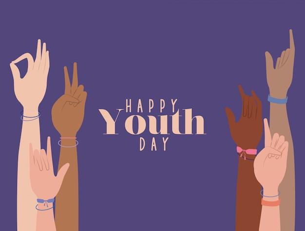 Mani in alto della felice giornata della gioventù