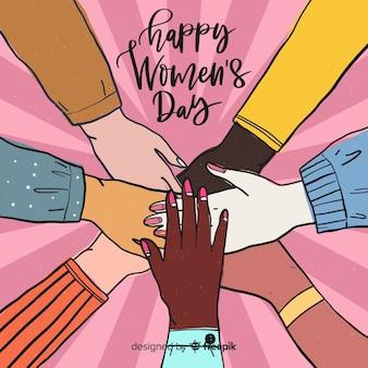 Mani insieme sullo sfondo del giorno della donna