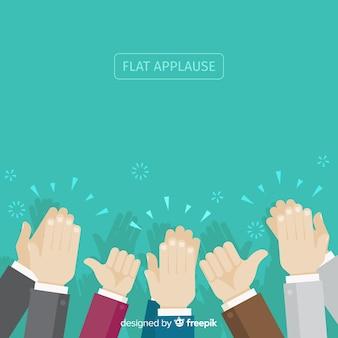 Mani piatte che applaudono sullo sfondo