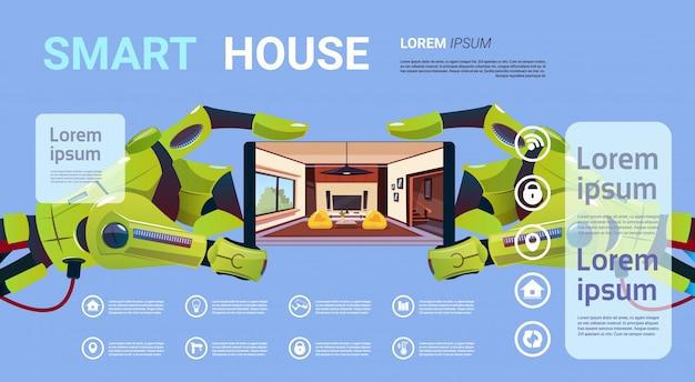 Mani robot che tengono smartphone con tecnologia dell'interfaccia del monitoraggio della casa intelligente del concetto della gestione domestica
