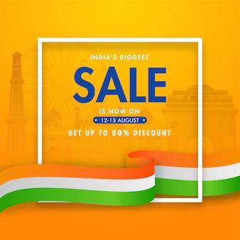 Manifesto di vendita più grande dell'india e nastro ondulato tricolore su sfondo arancione di monumenti famosi.