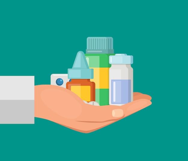 Mano cartone animato tenendo mucchio di pillole e bottiglia di farmaci
