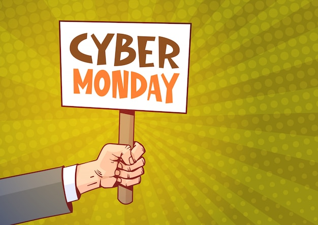 Mano che tiene cartello con testo cyber monday over sunburst