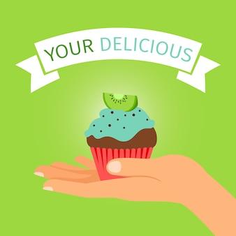 Mano che tiene il regalo di cupcake kiwi