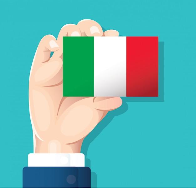 Mano che tiene la carta bandiera italia