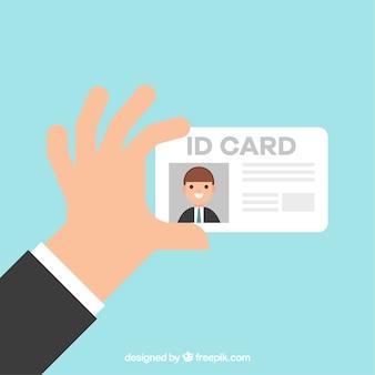 Mano che tiene la carta d'identità
