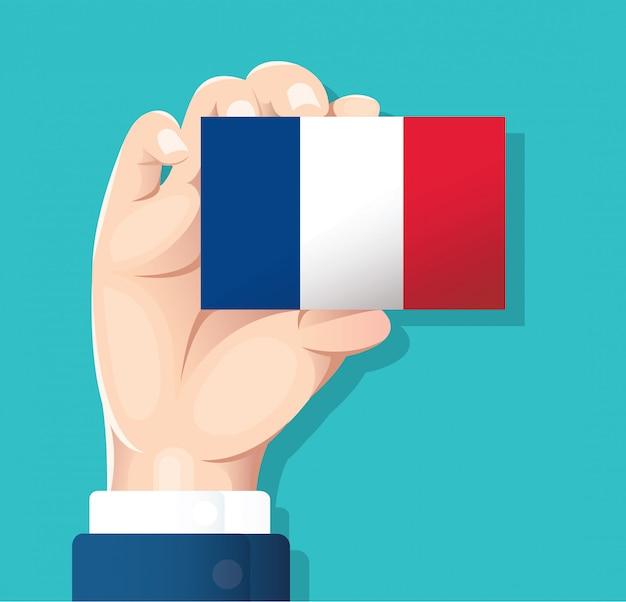 Mano che tiene la carta di bandiera della francia