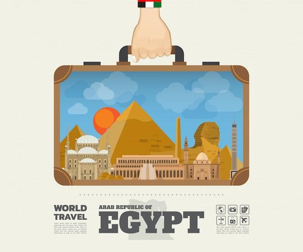 Mano che trasporta la borsa globale di infographic di viaggio e di viaggio del punto di riferimento dell'egitto