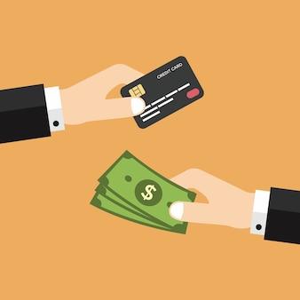 Mano con carta di credito e denaro