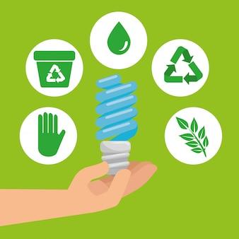 Mano con lampadina salva ed elemento ecologia