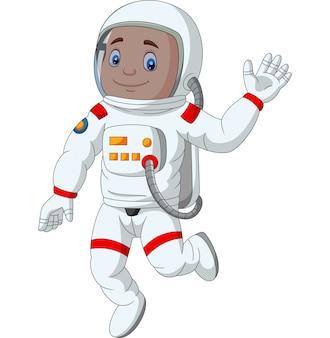 Mano d'ondeggiamento dell'astronauta del ragazzo del fumetto