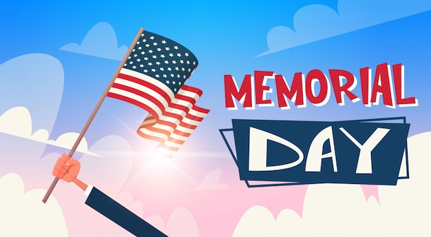 Mano del fumetto che tiene bandiera americana contro il sole memorial day background