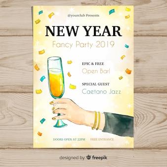 Mano dell'acquerello che tiene manifesto di vetro del nuovo anno