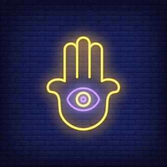 Mano di hamsa con segno al neon dell'occhio