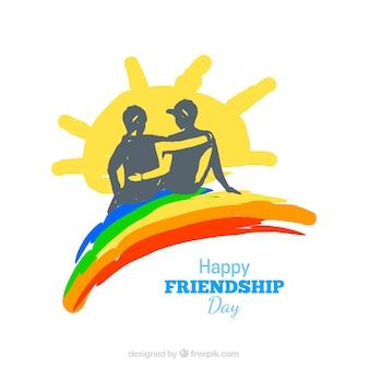 Mano dipinta di sfondo amicizia con arcobaleno e il sole