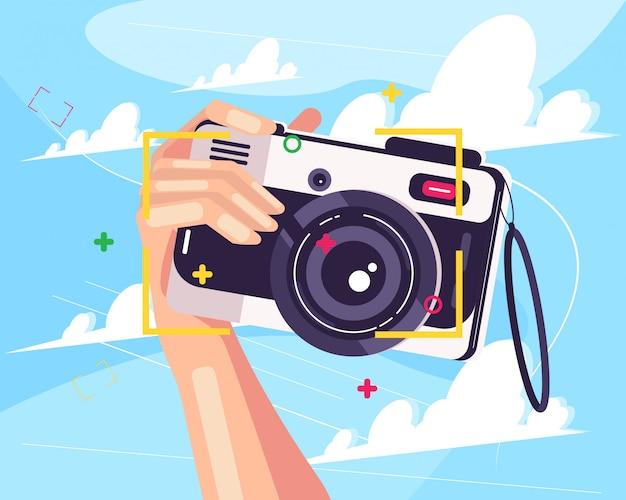 Mano e macchina fotografica