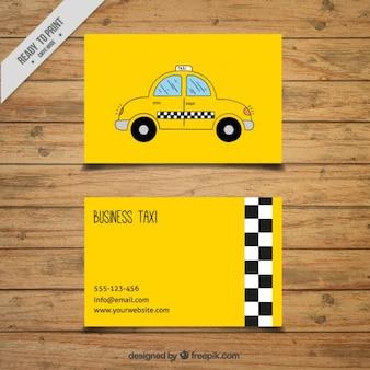 Mano il biglietto da visita di taxi disegnato