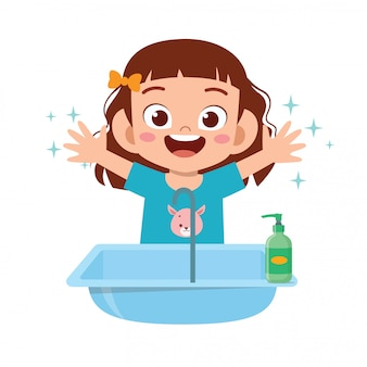 Mano sveglia felice della lavata della ragazza del bambino in lavandino