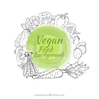 Mano vegan disegnato sfondo alimentare