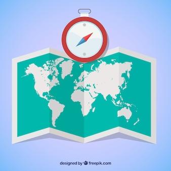 Mappa del mondo e bussola in design piatto