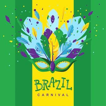 Maschera di carnevale brasiliano con piume e dolci su uno sfondo verde con una striscia gialla nel mezzo